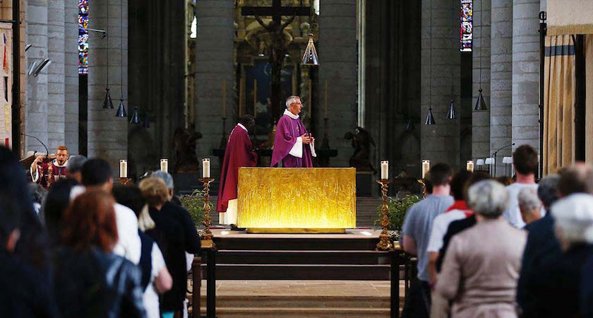 "People attend a mass at Rouen cathedral, on July 27, 2016 in Rouen, to pay tribute to the priest Jacques Hamel, killed on July 26 in a church of Saint-Etienne-du-Rouvray during a hostage-taking claimed by Islamic State group. France probes an attack on a church in which two men described by the Islamic State group as its ""soldiers"" slit the throat of a priest. An elderly priest had his throat slit in a church in northern France on July 26 after two men stormed the building and took hostages. The attack in the Normandy town of Saint-Etienne-du-Rouvray came as France was still coming to terms with the Bastille Day killings in Nice claimed by the Islamic State group. / AFP / CHARLY TRIBALLEAU (Photo credit should read CHARLY TRIBALLEAU/AFP/Getty Images)"