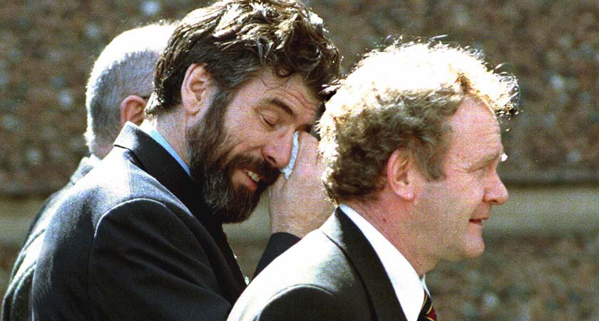 (FILES) File picture of Sinn Fein leader Gerry Adams (L) and then former IRA member who became Northern Ireland deputy first minister Martin McGuinness (R) showing on April 10, 1998 the strain of the all night and all day negotiations at Stormont, near Belfast, after a historic peace agreement was finally reached by the parties at the Northern Ireland peace talks, 17 hours after the midnight deadline. The Good Friday Agreement signed 10 years ago, was approved by a referendum. The agreement was promoted to the nationalist community as delivering civil rights, inclusive government, recognition of their Irishness, and a peaceful route to Irish reunification. AFP PHOTO ALAN LEWIS/FILES ==*NO MAGS* NO SALES* NO INTERNET* UK OUT*== (Photo credit should read ALAN LEWIS/AFP/Getty Images)