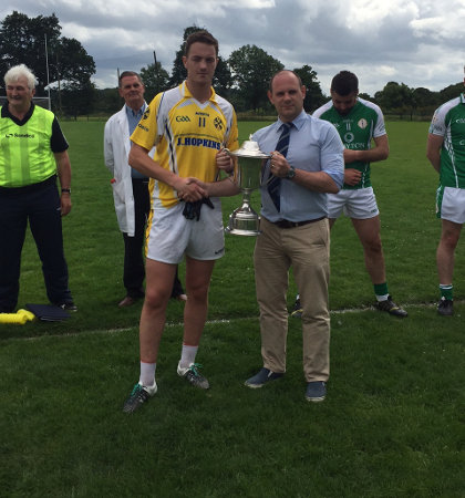 Ciaran Harper collects the cup from Sean Hackett
