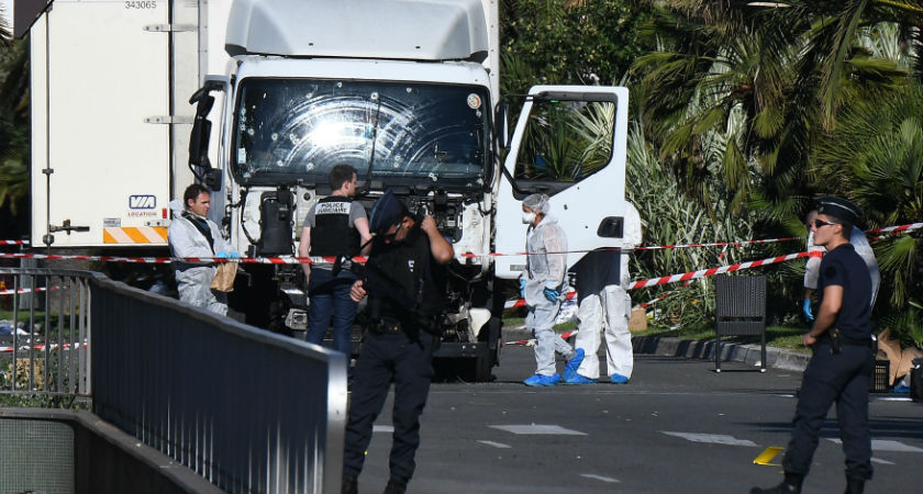 Forensics officers and policemen look for evidences in a truck on the Promenade des Anglais seafront in the French Riviera town of Nice on July 15, 2016 (ANNE-CHRISTINE POUJOULAT/AFP/Getty)