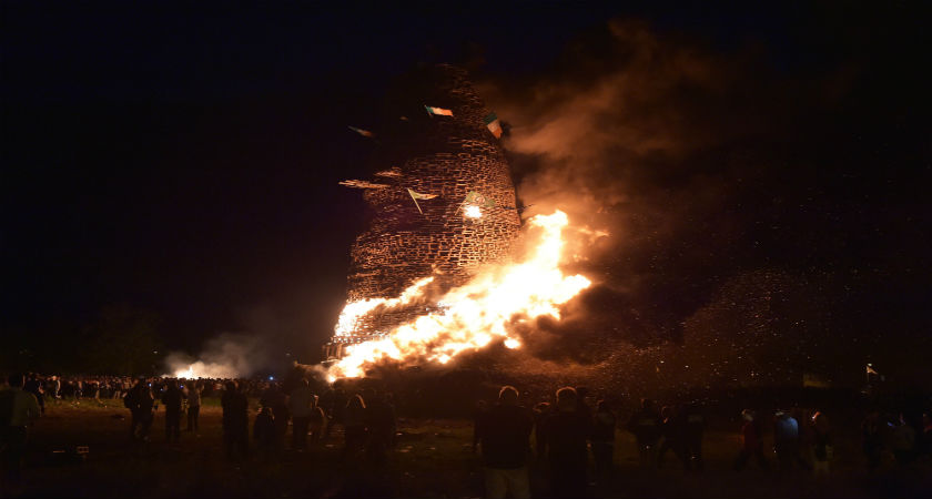 Hundreds of people gather for the 11th night bonfire as it is set alight at the New Mossley housing estate. (Getty)