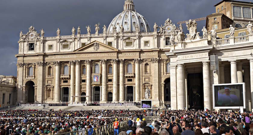 Rome, Italy - October 22, 2014: Papal Audience in St. Peter's Square, Vatican City with the Pope Francis praying under the canopy and an crowd in square San Pietro on October 22, 2014.