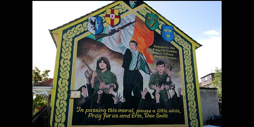 A nationalist mural in Belfast dedicated to Bobby McCrudden, Mundo O' Rawe and Pearse Jordan. All were killed whilst IRA volunteers. (Photo credit should read FRAN CAFFREY/AFP/Getty Images)