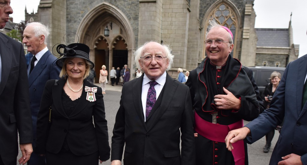 Irish President Michael D. Higgins (C) arrives for the funeral of the late retired Bishop of Derry, Dr. Edward Daly (Photo by Charles McQuillan/Getty Images)