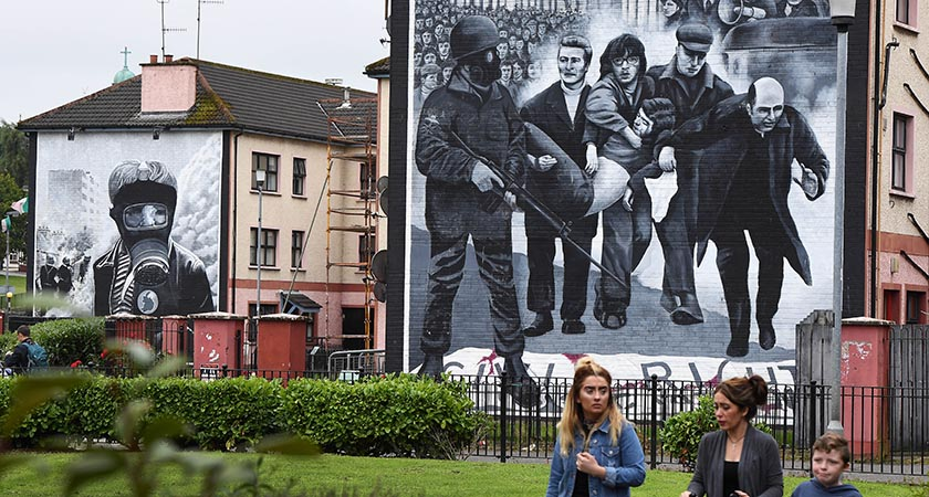A Mural stands in Derry depicting the moment during Bloody Sunday of Bishop Edward Daly and Jackie Duddy (Photo by Charles McQuillan/Getty Images)
