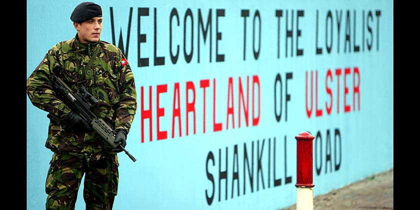 A British soldier in front of a UDA mural on the lower Shankill road, Belfast. (Photo: Stringer/Getty Images)