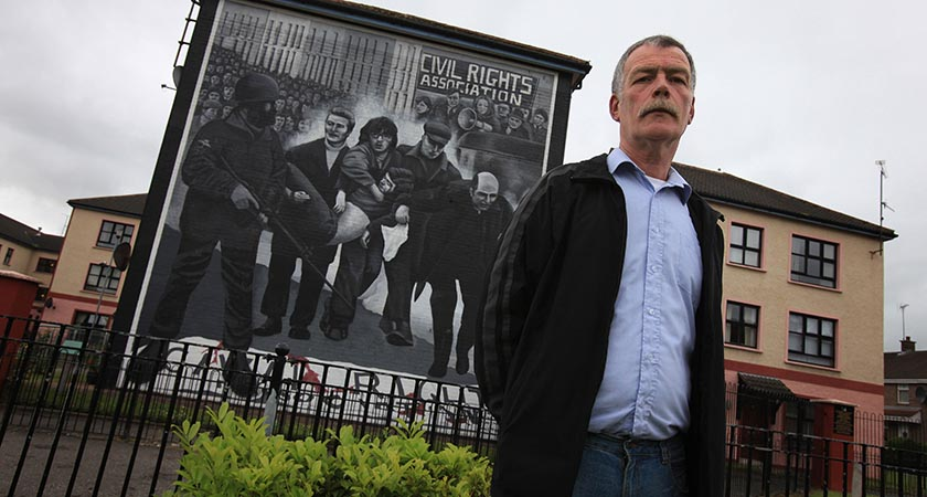 Gerry Duddy, brother of John 'Jack' Duddy, stands in front of a mural depicting his brother being carried to safety as Father Daly waves a white handkerchief in Londonderry, Northern Ireland on June 11, 2010. Jack Duddy was the first to be shot and was killed by a single bullet to the chest on January 30, 1972 in the Bogside area of Londonderry, in Northern Ireland. The Saville Inquiry into Bloody Sunday will be published on June 15, 2010 after 12 years and a cost of ?190 million pounds (275 million dollars, 230 million euros), the 5,000-page report examines the events of January 30, 1972 in Londonderry, Northern Ireland, when 13 civilians were shot dead by British soldiers at a civil rights march. Another man died later from his wounds. AFP PHOTO/ Peter Muhly (Photo credit should read PETER MUHLY/AFP/Getty Images)