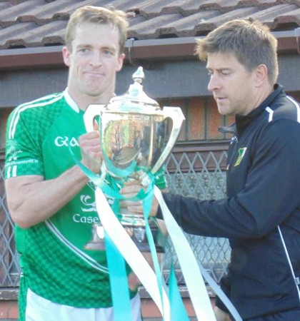Captain Niall McCooey receives the cup