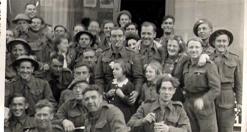 Arromanches 1944 – Liam front row far right eating out of a can