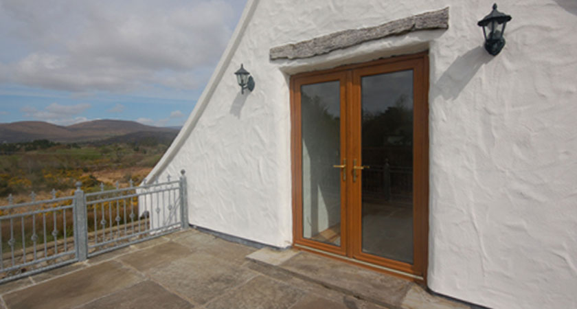 The roof terrace offers spectacular views and has outdoor access via a paved stairwell