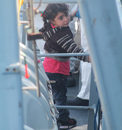 A little girl waits to board the LÉ Niamh. (Picture: courtesy of the Irish Defence Forces)