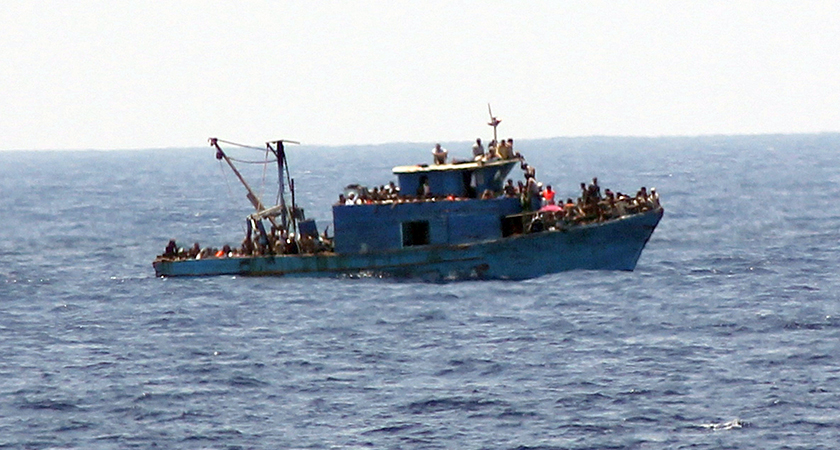 An image of a fishing trawler with over 600 migrants on board, shortly before it capsized. The LÉ Niamh rescued 367 people, and recovered 25 bodies. (Picture: courtesy of the Irish Defence Forces)