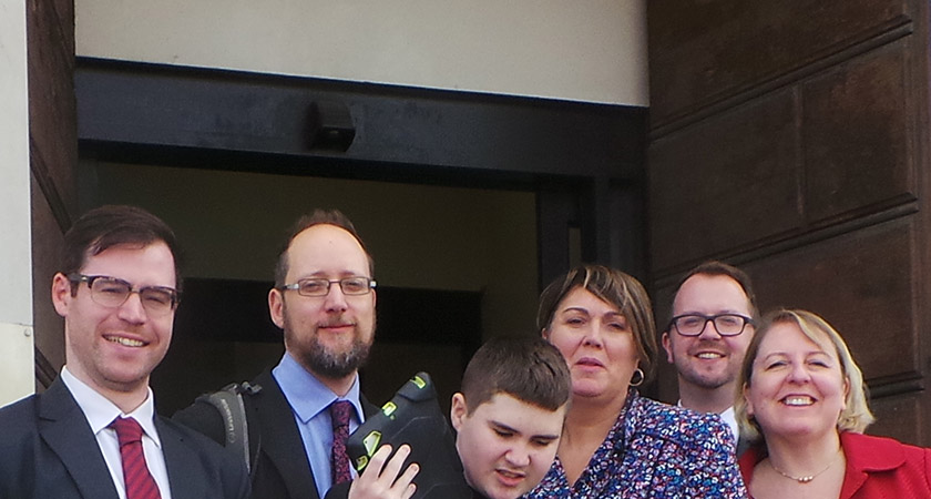 Jimmy with his mother and legal team outside Bow County Court