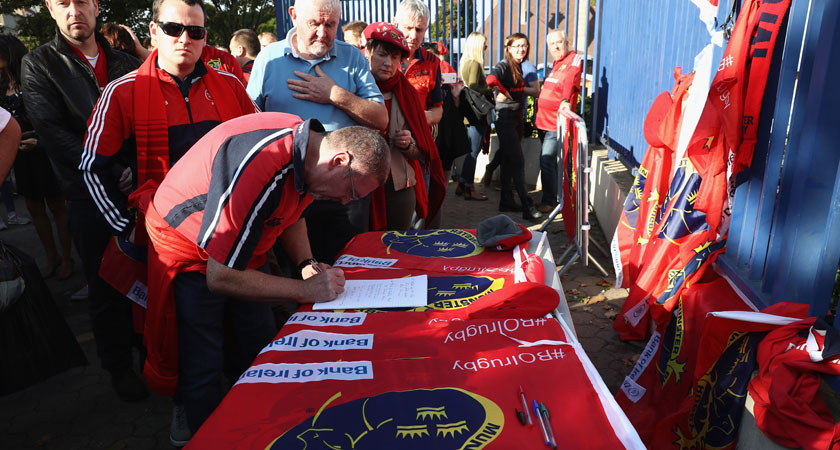 Munster fans in Paris sign a book of condolence for Anthony Foley [Image: Getty]