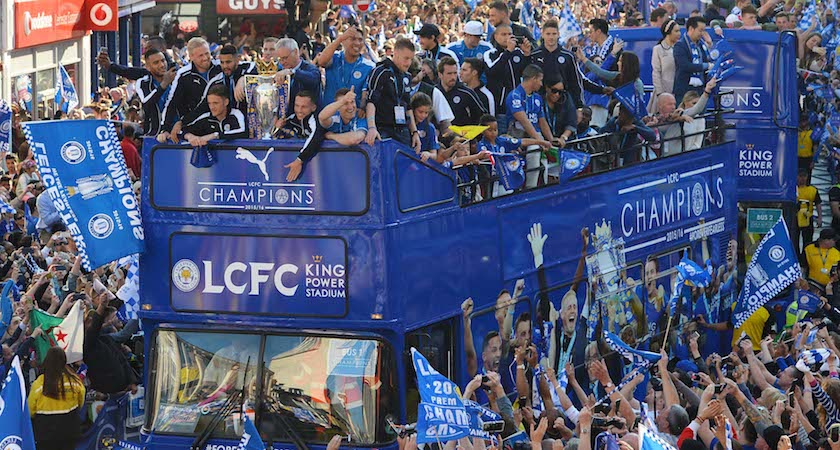Leicester City's Italian manager Claudio Ranieri (C) stands with the Premier league trophy as the Leicester City team take part in an open-top bus parade through Leicester to celebrate winning the Premier League title on May 16, 2016. / AFP / GLYN KIRK (Photo credit should read GLYN KIRK/AFP/Getty Images)