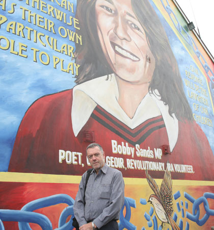 Stopping off at the Bobby Sands mural on the Falls Road during a Belfast Black Cab tour