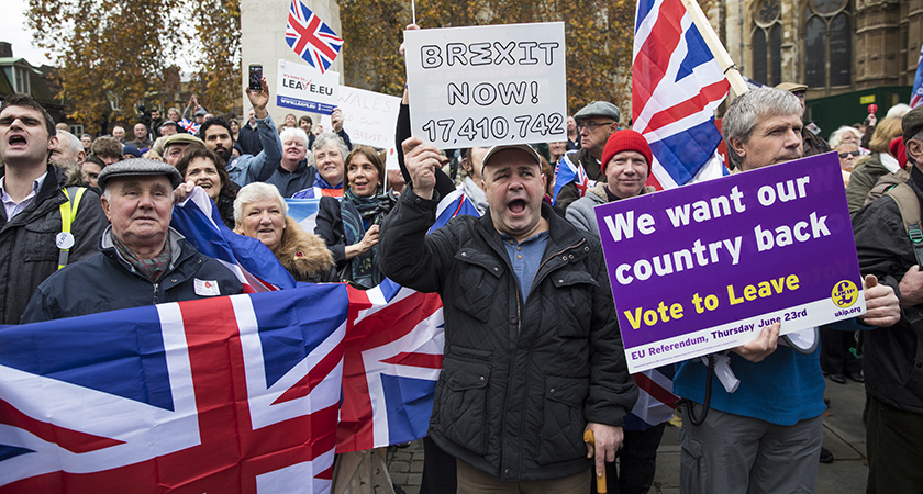 """LONDON, ENGLAND - NOVEMBER 23: Pro-Brexit demonstrators protest outside the Houses of Parliament on November 23, 2016 in London, England. British Prime Minister Theresa May has said that she will not delay triggering article 50, the formal process of leaving the European Union, but wants to avoid a """"cliff edge"""". (Photo by Jack Taylor/Getty Images)"""