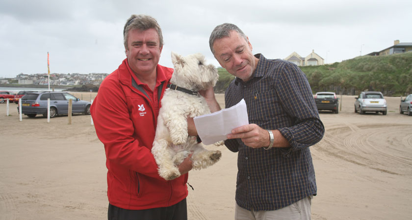 Ex-policeman Andy Robinson and his West Highland terrier at Portstewart Strand
