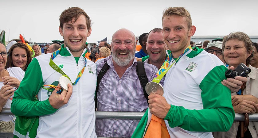 Paul and Gary O'Donovan celebrate winning a silver medal with father Teddy and brother David O'Donovan [Picture: INPHO/Morgan] Treacy