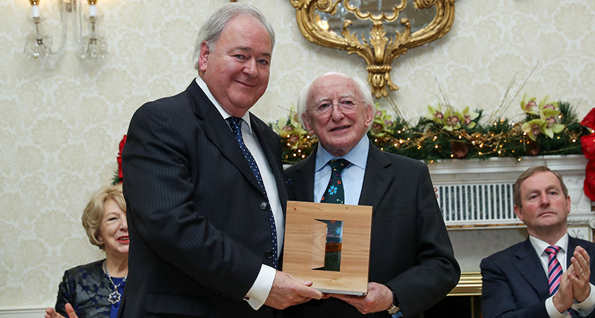 Brian Wogan collectshis brother's award from President Michael D. Higgins [Picture: Maxwell Photography]