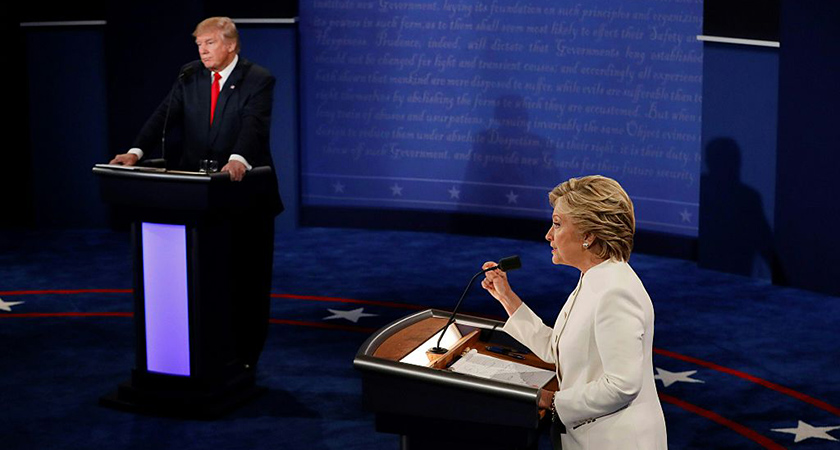 TOPSHOT - Democratic presidential nominee Hillary Clinton (R) speaks as Republican presidential nominee Donald Trump looks on during the final presidential debate at the Thomas & Mack Center on the campus of the University of Las Vegas in Las Vegas, Nevada on October 19, 2016. / AFP / Mark RALSTON (Photo credit should read MARK RALSTON/AFP/Getty Images)