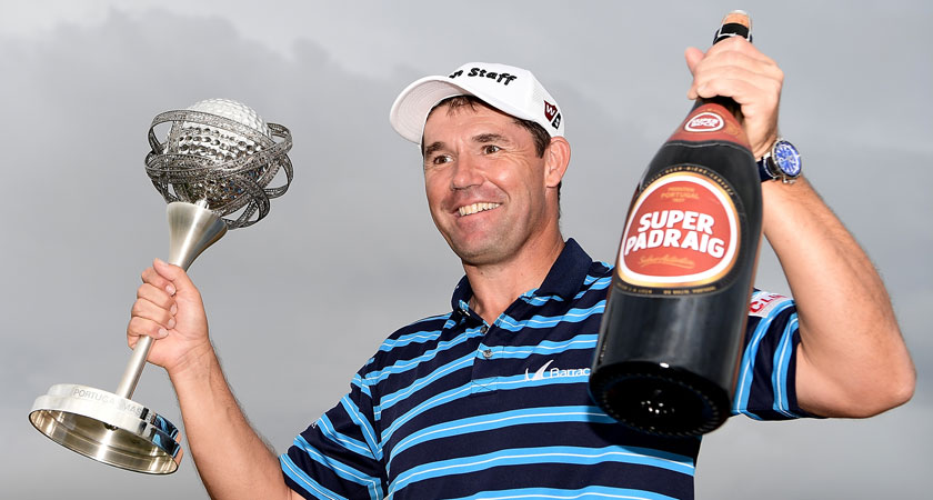 Padraig Harrington poses with the trophy and a bottle of beer following his victory during day four of the Portugal Masters in October (Image: Stuart Franklin/Getty Images)