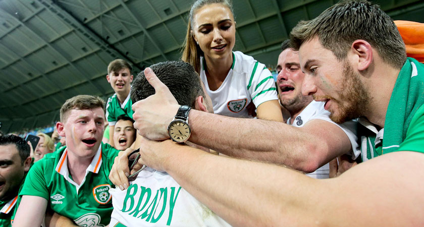 Robbie Brady celebrates with family and fans after his winner against Italy (Image: inpho.ie)
