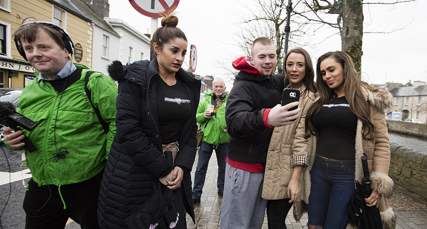 A local man takes a selfie with the models. Photo: Eamonn Farrell/RollingNews.ie