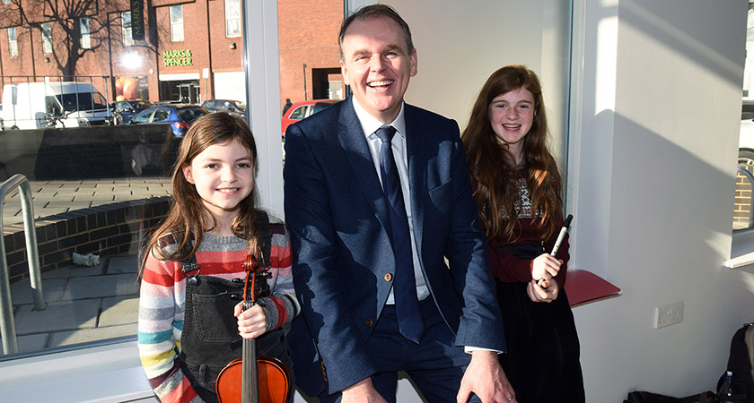 Joe McHugh TD, Minister of State for the Diaspora and Overseas Development Aid, with musicians Francesca and Madelaine Cottrell-Kirby (Picture: Malcolm McNally)