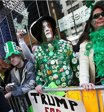 A Donald Trump for President supporter and other revelers look on during an annual St. Patrick's Day parade in New York City. (Photo by Mario Tama/Getty Images)