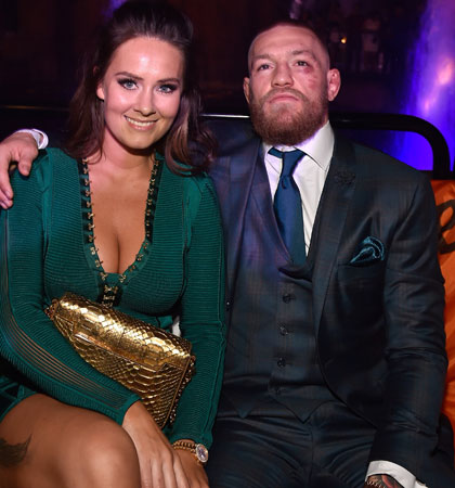 Would you ditch your other half on Valentine's Day to spend time with Conor McGregor and his partner Dee Devlin? (Image: Getty)
