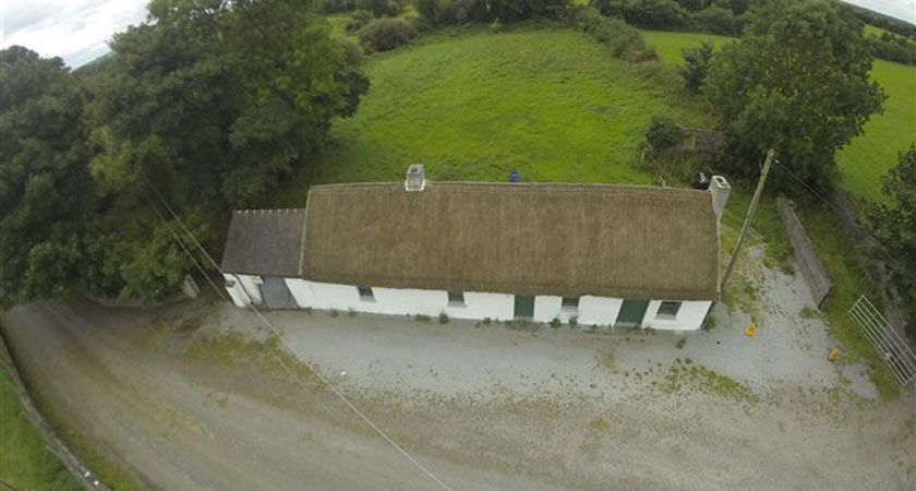 An aerial view of the property, which is sheltered by mature broadleaf trees (Image: myhome.ie)
