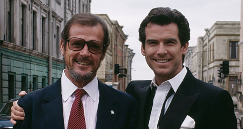 Sir Roger Moore and Pierce Brosnan together in 1995 at the premiere of GoldenEye.