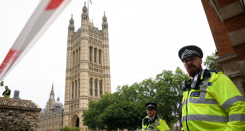 Police officers secure the roads around the Houses of Parliament