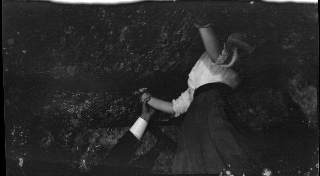 Kathleen Kennedy twisting upside down in a skirt to kiss Ireland's famous Blarney Stone way in 1937.
