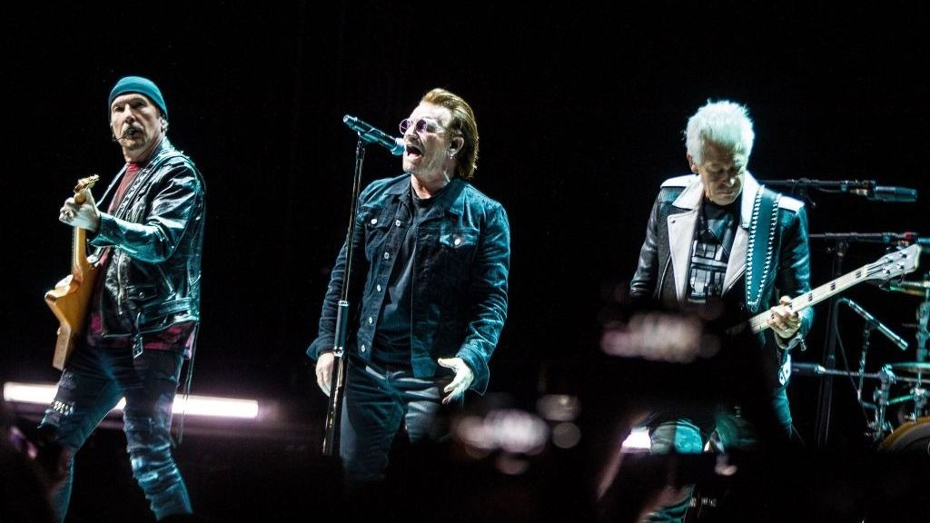 Bono performing with US.