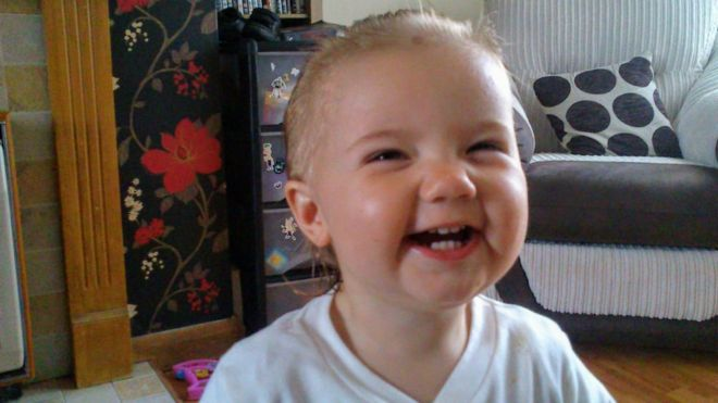 Mother of two-year-old who died in 2013 makes emotional appeal for stolen lock of hair.