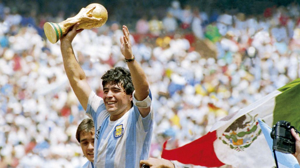 Diego Maradona lifting the World Cup for Argentina.