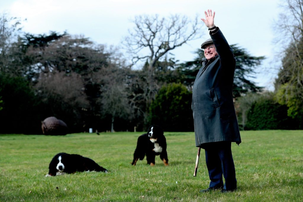 Michael D Higgins takes his new puppy Misneach for walk around grounds of Aras an Uachtarain.