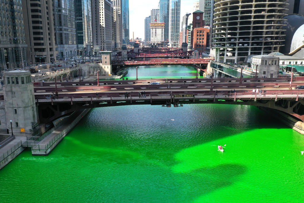 CHICAGO, ILLINOIS - MARCH 13: An aerial picture shot with a drone shows the Chicago River as it flows through downtown after it was dyed green in celebration of St. Patrick's Day on March 13, 2021 in Chicago, Illinois. The dyeing of the river, a St. Patrick's Day tradition in the city, was cancelled last year due to the COVID-19 pandemic. It was reported to be cancelled this year but the city approved a last-minute early-morning clandestine dyeing to keep the usual spectators at bay.